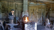 Stoking the fire in the forge