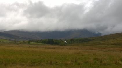 Clouds shroud the peaks in mystery