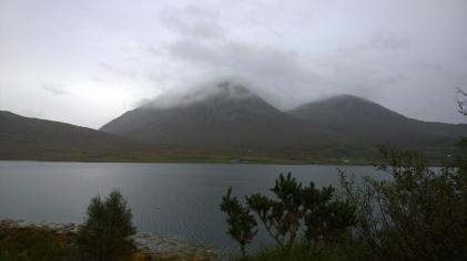 Peaks shrouded in clouds.