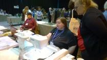 Liz demoing the embroidery machine
